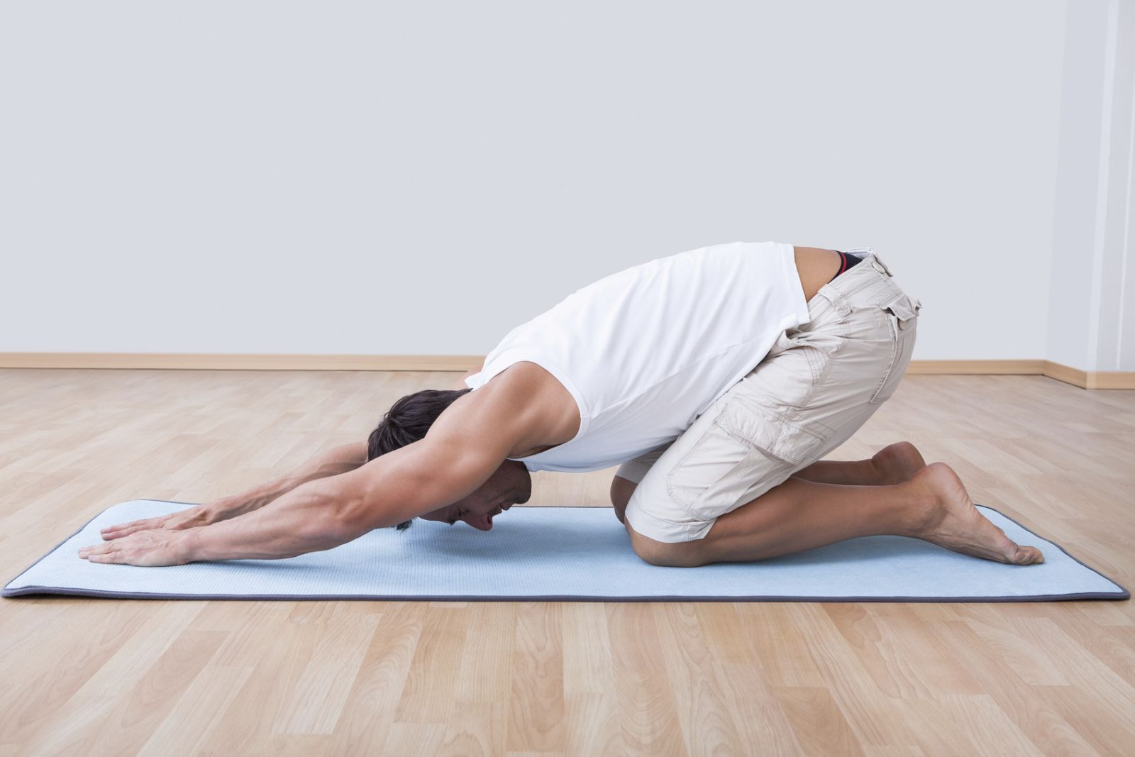 man-doing-yoga-childs-pose-back-stretch-AndreyPopov-iStock_24194848_MEDIUM