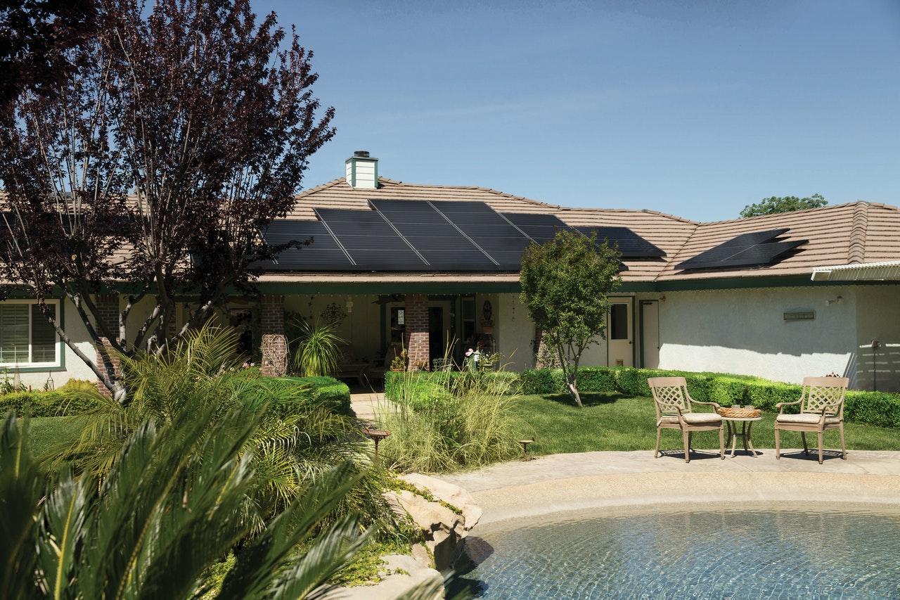 black-solar-panels-on-brown-roof-2850347