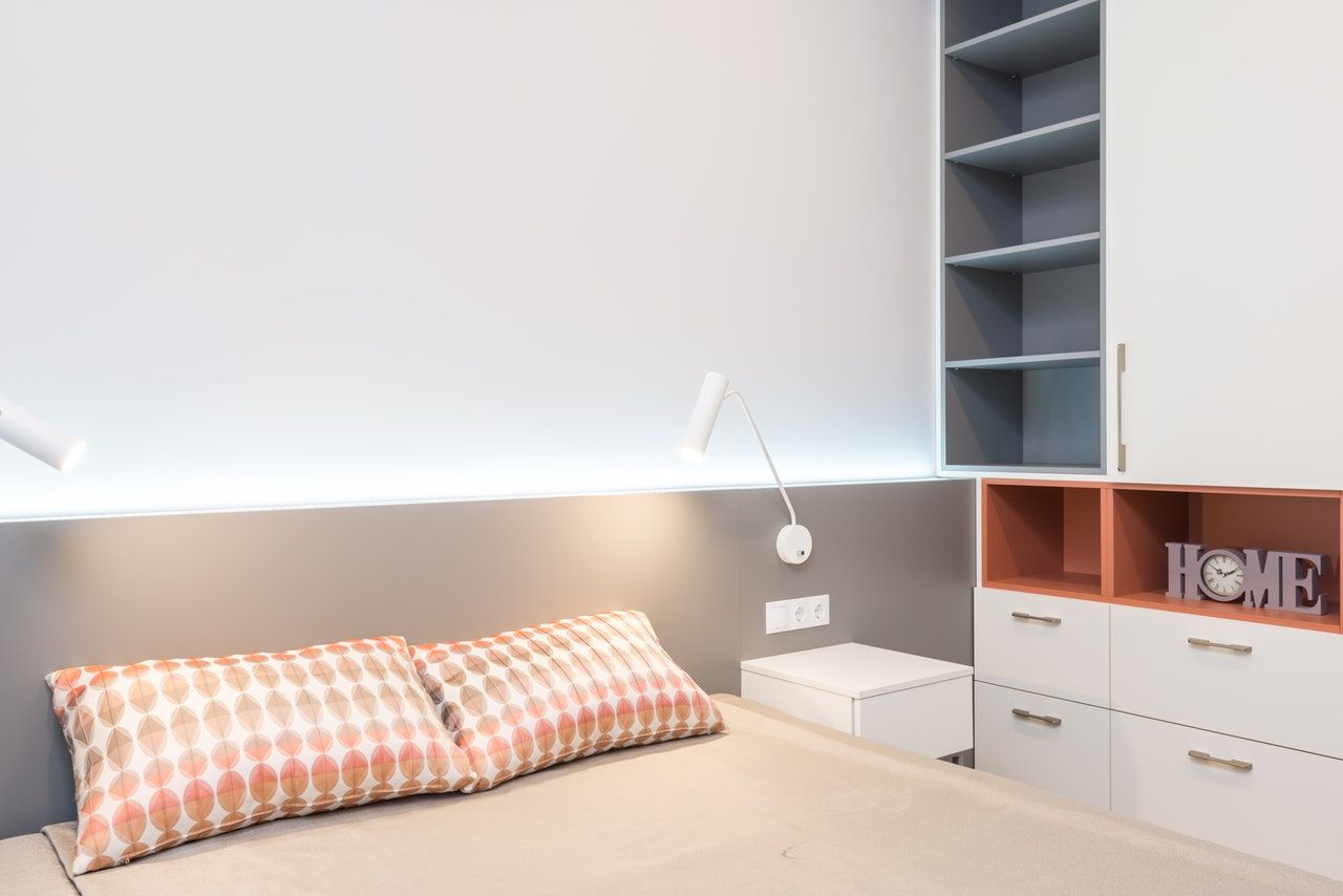 shelves and cabinets in small bedroom